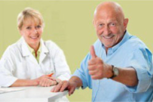 elderly woman with elderly man showing his thumbs up