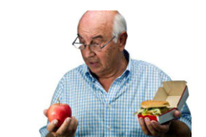 elderly man holding burger and apple
