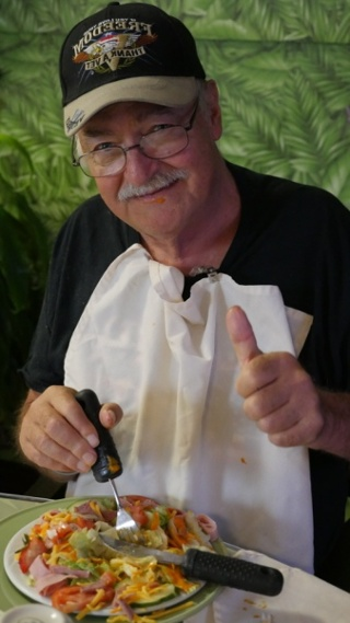 elderly man showing his thumbs up