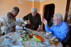 group of elderly enjoying a home-style meal
