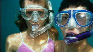 couple wearing snorkel underwater